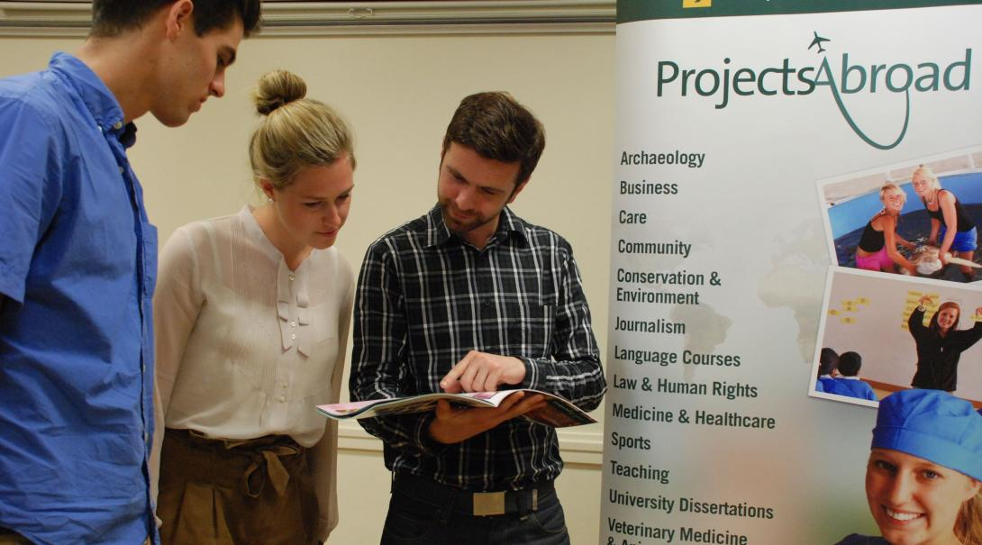 Projects Abroad staff talk to potential volunteers during an information event in France.